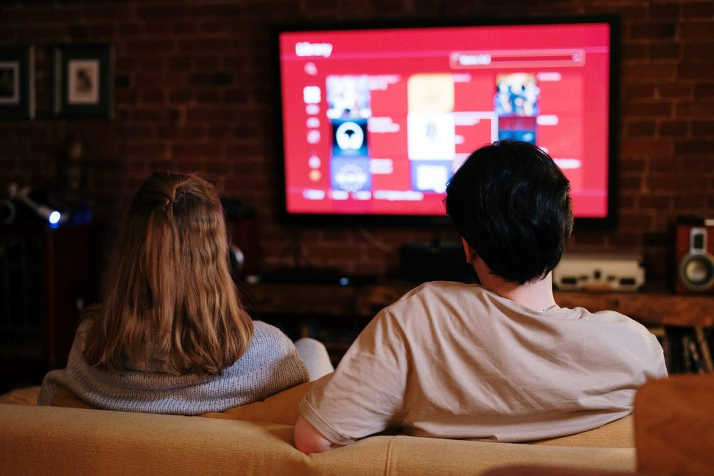 couple watching a streaming service on their couch